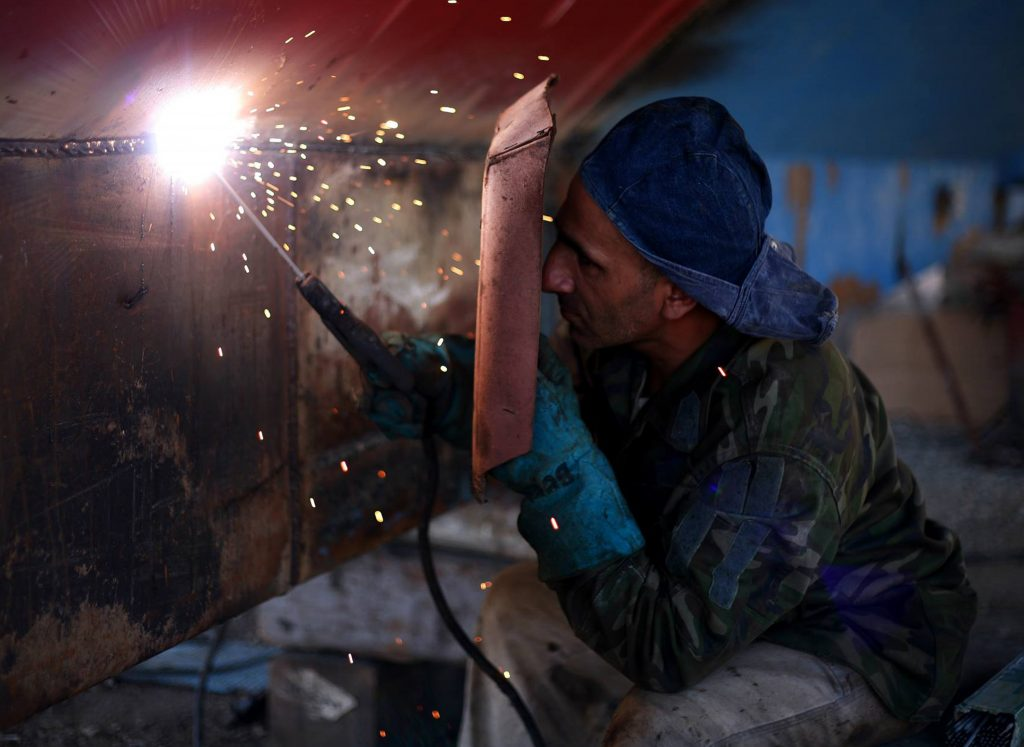 A pic of a welder reminding you that if you do the work on your funnel, you'll get paid